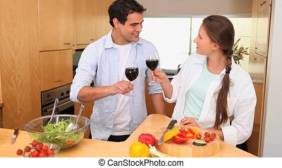 Couple holding wine glasses in the kitchen