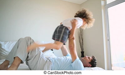 Man raising his son in the air