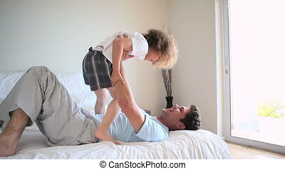 Man playing with his son