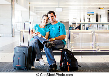 loving young couple at airport - loving young couple waiting...