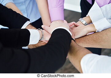 business people group joining hands and representing concept...