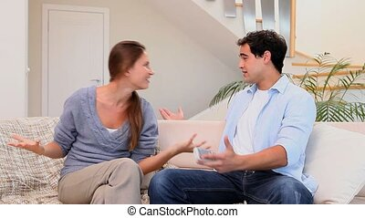 Woman angry with her husband in the living room
