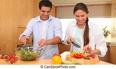 Couple making a salad