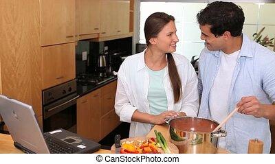 Man tasting his girlfriends cooking