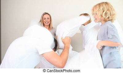 Family having a pillow fight against the father