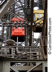 Elevator of the Eiffel Tower in Paris - Detail of a red and...