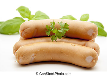 Frankfurter with herbs on white background