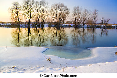 frozen river - Sunset over frozen river in winter
