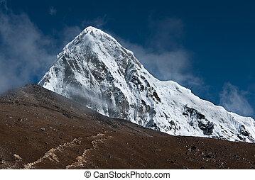 Pumori, Kala Patthar and cloudy sky in Himalayas