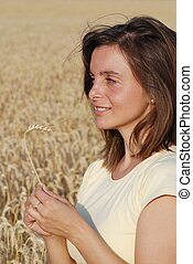 Woman with wheat in hands
