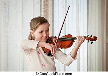 Child playing violin indoors - Cute child (little girl)...