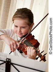 Child playing violin at home - Cute child little girl...