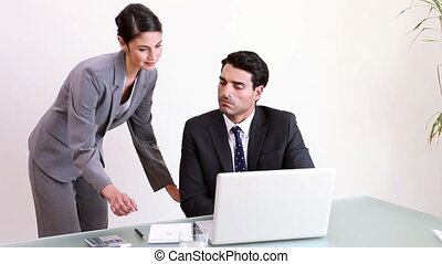 Businessman working with his secretary in his office