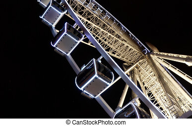 Gondolas On A Ferris Wheel - Suspended passenger gondolas on...