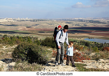 father and son during a hike looking at their hometown