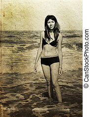 beautiful girl on the beach. Photo in old color image style.