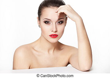 portrait of sexy sitting caucasian young woman model with glamour red lips,bright makeup, eye arrow makeup, purity complexion. Perfect clean skin