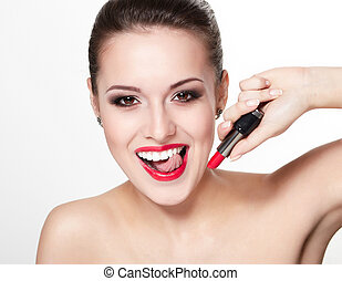 closeup portrait of sexy smiling caucasian young woman model with glamour red lips,bright makeup, eye arrow makeup, purity complexion with red lipstick. Perfect clean skin. white teeth