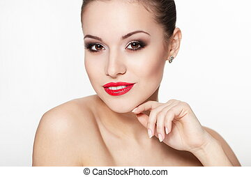 closeup portrait of sexy smiling caucasian young woman model with glamour red lips,bright makeup, eye arrow makeup, purity complexion. Perfect clean skin.white teeth