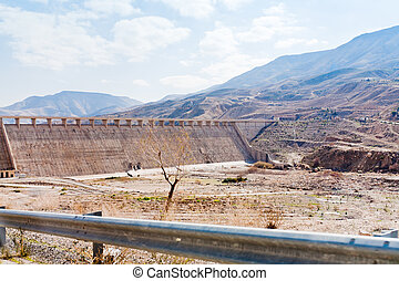 wall of Wadi Al Mujib dam in mountain valley in Jordan
