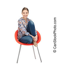 happy and carefree teenage girl in chair - bright picture of...