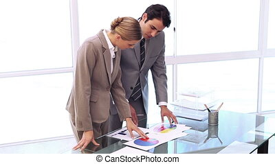 Business people working together on charts