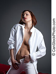 Desired young woman in white shirt undress jeans