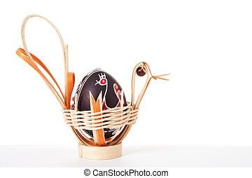 Easter eggs in basket isolated on white background