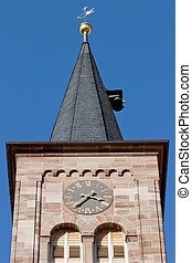 Church spire in front of a blue sky