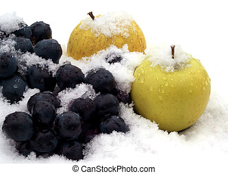apples on snow - apples and grapes on snow in garden