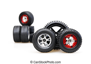 Rubber tires on red rims on a white background