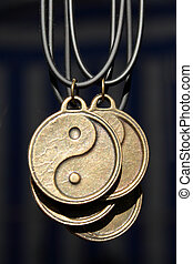 yinyang pendents on dark background