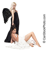 Angel and devil - Two girls representing scene between angel...
