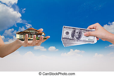 Hand exchange House with Dollar over blue sky