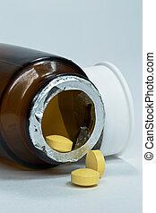 Opened bottle of pills