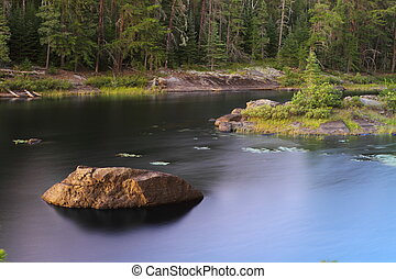 Serene lake - Beautiful calm lake in a remote wilderness of...