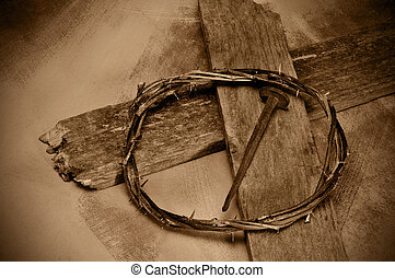Jesus Christ cross, nail and crown of thorns - closeup of a...