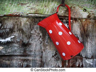 Vintage Jug - Vintage red jug hanging on rustic wooden wall