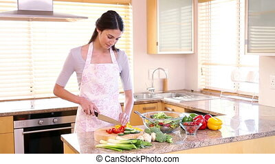 Young woman preparing a salad