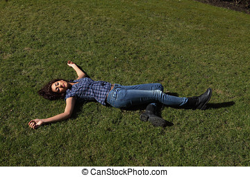 Dead female - Female dead body lying in a park, full length...
