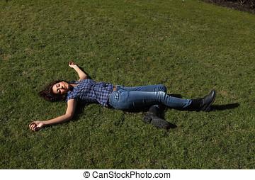 Dead female - Female dead body lying in a park, full length...
