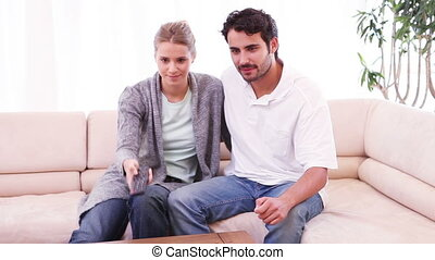 Smiling couple watching the television