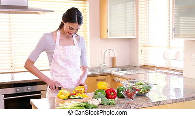 Smiling woman preparing a meal