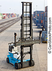 Lifting machine in container area - Crane work its job in...