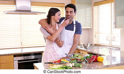 Couple hugging each other in the kitchen