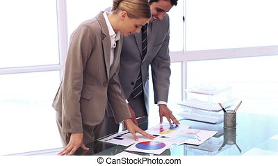 Business people working on professional documents in an...