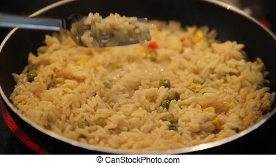 cooking rice in a frying pan