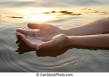 woman hands in water inviting you