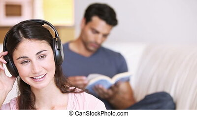 Young relaxed woman listening to music