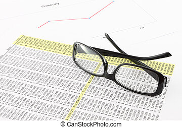 Eye glasses on business information.